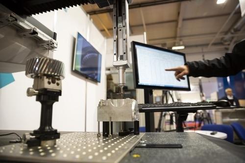 a metal contractor using ornamental metal design software in a shop