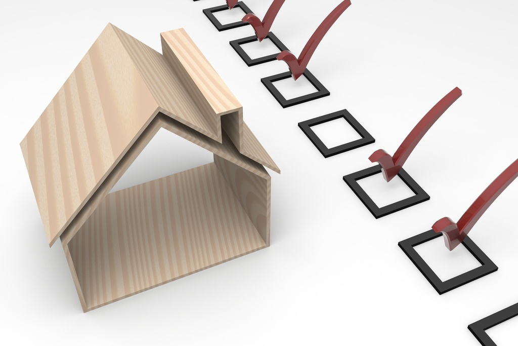 An image of a wooden house with several boxes and red checks next to them. Professional home inspection includes all of the major systems associated with residential homes